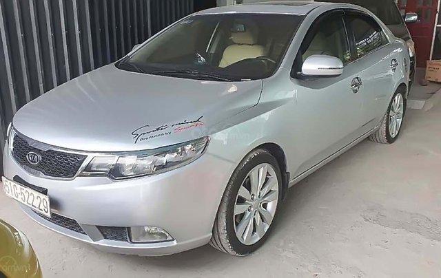 Cần bán Kia Forte AT 2012, màu bạc số tự động0