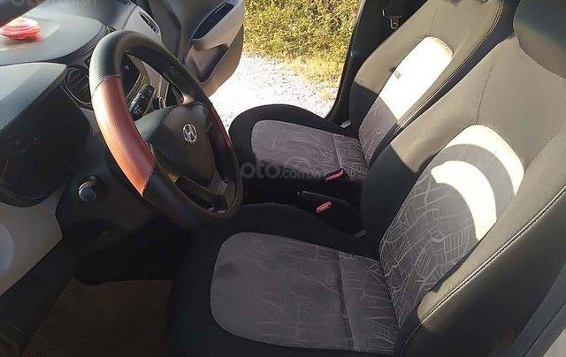 Cần bán gấp Hyundai Grand i10 1.0 MT đời 2014, màu bạc, nhập khẩu nguyên chiếc số sàn4