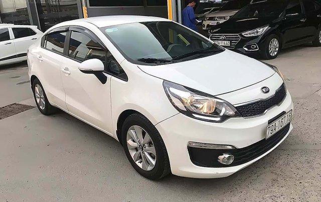 Cần bán lại xe Kia Rio 1.4AT 2016, màu trắng, nhập khẩu số tự động0