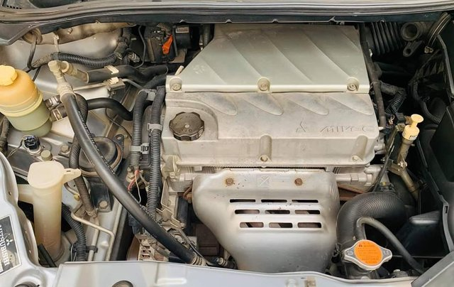 Bán ô tô Mitsubishi Grandis, năm sản xuất 2009, màu bạc9