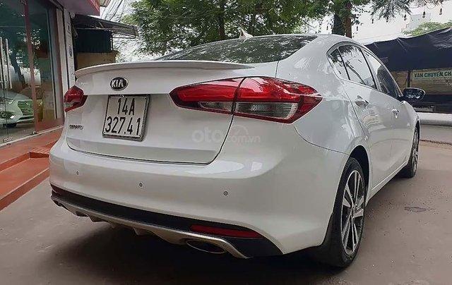 Cần bán Kia Cerato 1.6 AT sản xuất 2018, màu trắng, giá 593tr1