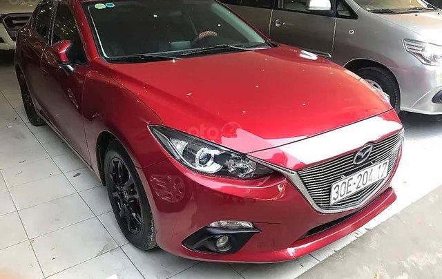 Cần bán xe Mazda 3 1.5 AT đời 2015, màu đỏ số tự động0