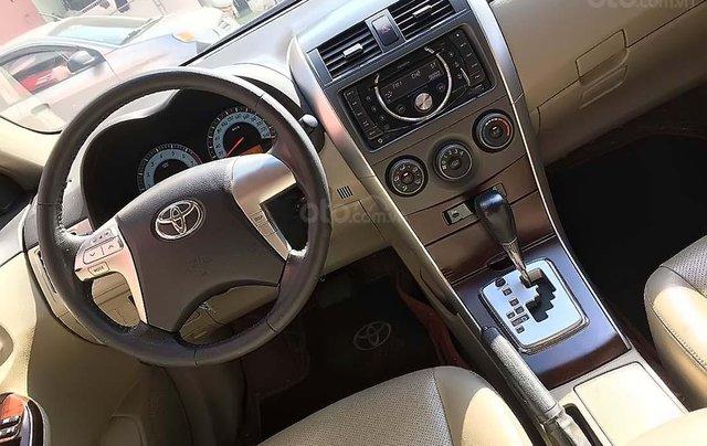 Cần bán gấp Toyota Corolla Altis đời 2011, màu bạc, số tự động3