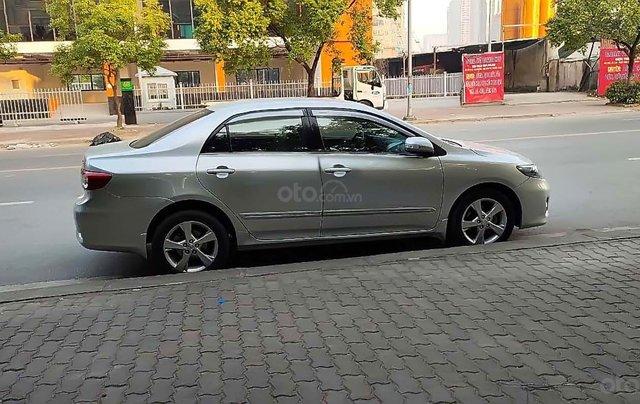 Bán Toyota Corolla Altis đời 2011, màu bạc xe còn mới lắm1