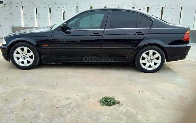 Cần bán lại xe BMW 318i đời 2001, màu đen chính chủ0