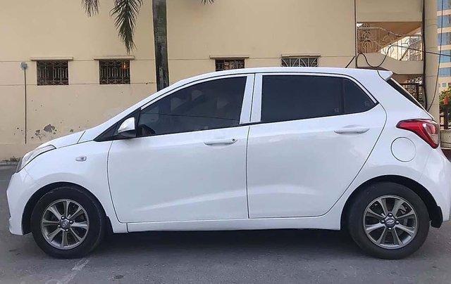 Cần bán Hyundai Grand i10 1.0 MT Base 2015, màu trắng, nhập khẩu1