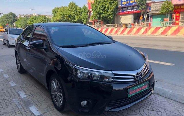 Cần bán gấp Toyota Corolla Altis 1.8G AT đời 2015, màu đen, xe gia đình0