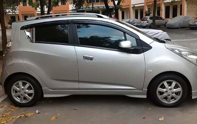Cần bán lại xe Chevrolet Spark LT 1.2 MT sản xuất 2012, màu bạc còn mới giá cạnh tranh0