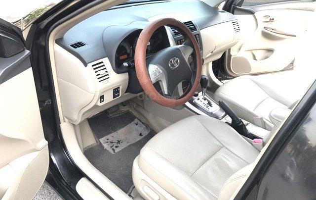 Toyota Corolla Altis 1.8G AT cuối 2011, số tự động, màu đen 1 chủ từ mới - nguyên zin cả xe, mới quá đi3