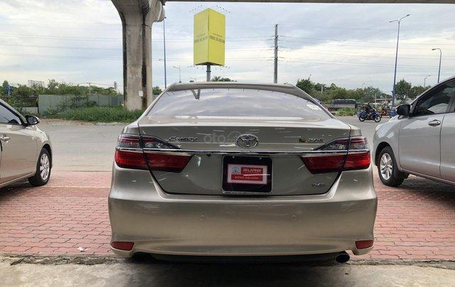Cần bán Toyota Camry 2.0E số tự động, màu nâu vàng, biển số thành phố, xe cá nhân gia đình sử dụng đi 28.673 km, xe còn rất mới4