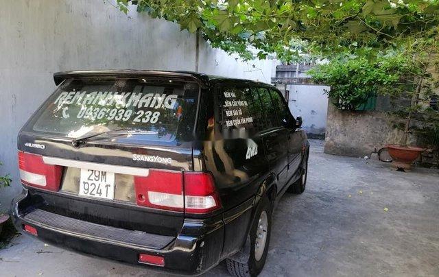Cần bán xe Ssangyong Musso năm 2001, màu đen 0