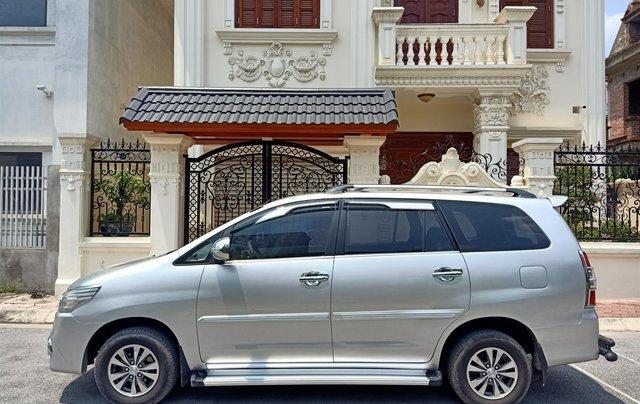 Cần bán Toyota Innova E 2014, số sàn, màu bạc đẹp, xe còn rất mới, anh Thành0