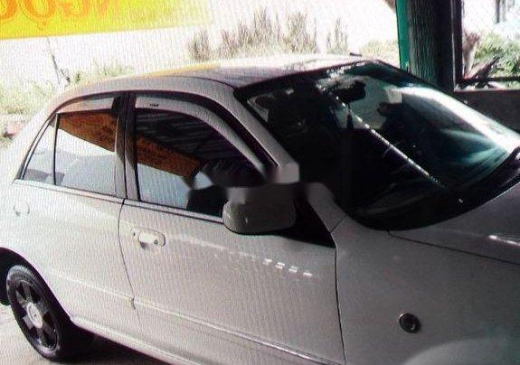 Gia đình bán xe Ford Laser đời 2003, màu trắng, nhập khẩu0