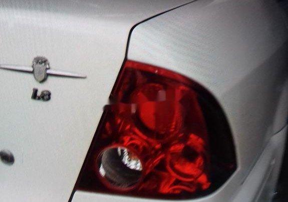 Gia đình bán xe Ford Laser đời 2003, màu trắng, nhập khẩu11