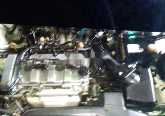 Gia đình bán xe Ford Laser đời 2003, màu trắng, nhập khẩu1