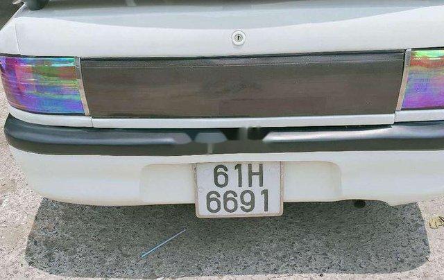 Cần bán gấp Mazda 323 đời 1995, màu trắng2