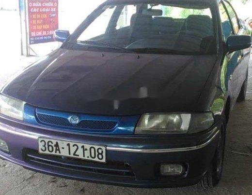 Bán xe Mazda 323 2000, màu xanh lam, nhập khẩu, còn tương đối đẹp6
