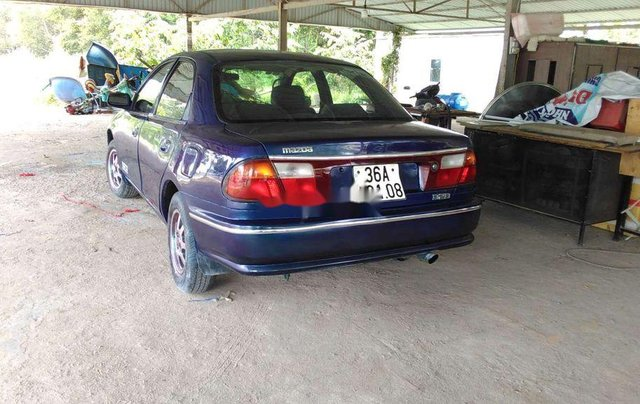 Bán xe Mazda 323 2000, màu xanh lam, nhập khẩu, còn tương đối đẹp2