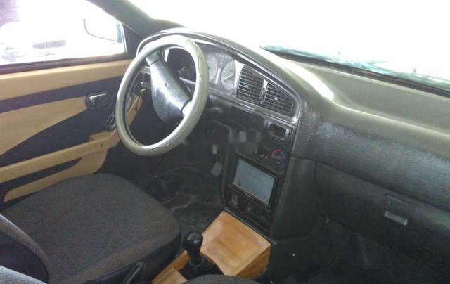 Bán xe Mazda 323 2000, màu xanh lam, nhập khẩu, còn tương đối đẹp4
