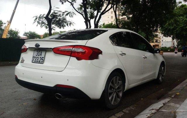 Cần bán gấp Kia K3 sản xuất năm 2015, màu trắng chính chủ8