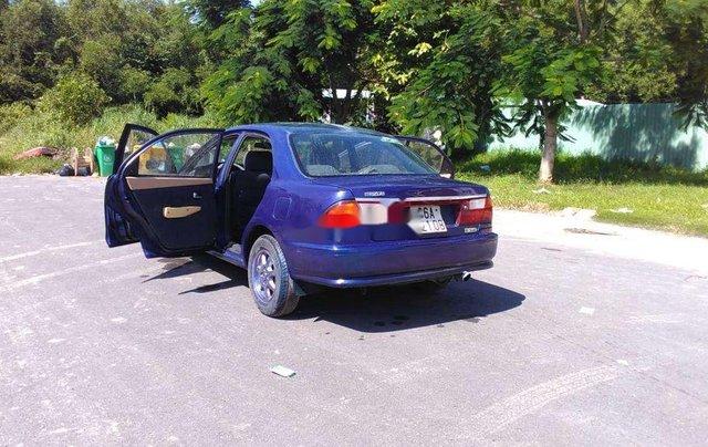 Bán xe Mazda 323 2000, màu xanh lam, nhập khẩu, còn tương đối đẹp11