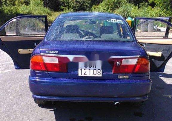 Bán xe Mazda 323 2000, màu xanh lam, nhập khẩu, còn tương đối đẹp9