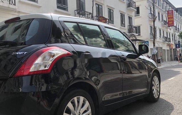 Bán Suzuki Swift đời 2014, màu đen, nhập khẩu chính chủ3