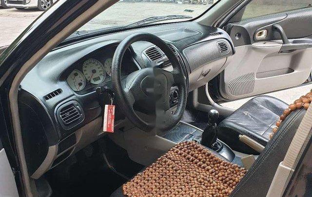 Bán Mazda 323 năm sản xuất 2001, màu đen, nhập khẩu 7