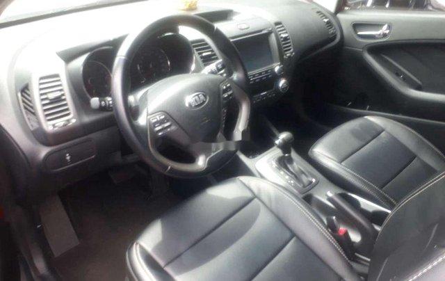Cần bán lại xe Kia K3 sản xuất 2015, màu đỏ số tự động3