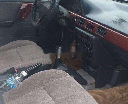 Bán Mazda 323 sản xuất năm 1995, màu trắng, nhập khẩu, máy lạnh đầy đủ4