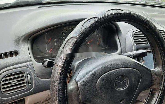 Chính chủ bán xe Mazda 323 sản xuất 2002, màu xám, nhập khẩu2