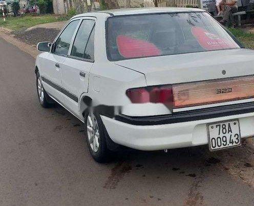 Bán Mazda 323 sản xuất năm 1995, màu trắng, nhập khẩu, máy lạnh đầy đủ3