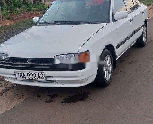 Bán Mazda 323 sản xuất năm 1995, màu trắng, nhập khẩu, máy lạnh đầy đủ1