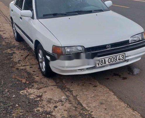 Bán Mazda 323 sản xuất năm 1995, màu trắng, nhập khẩu, máy lạnh đầy đủ0