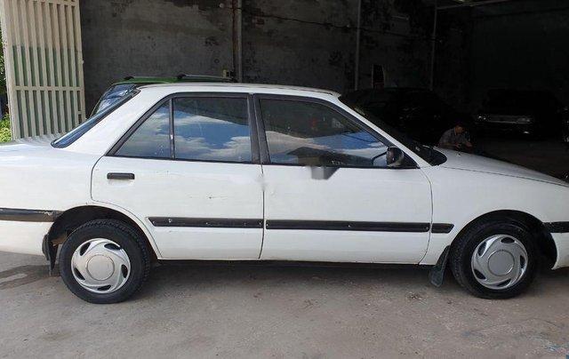 Bán lại xe Mazda 323 đời 1995, màu trắng, xe nhập, đồng sơn ok4