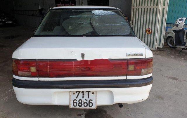 Bán lại xe Mazda 323 đời 1995, màu trắng, xe nhập, đồng sơn ok2