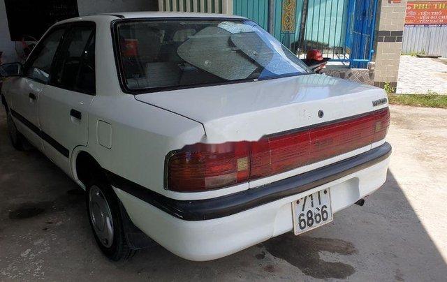 Bán lại xe Mazda 323 đời 1995, màu trắng, xe nhập, đồng sơn ok5