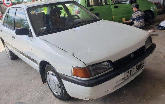 Bán lại xe Mazda 323 đời 1995, màu trắng, xe nhập, đồng sơn ok3