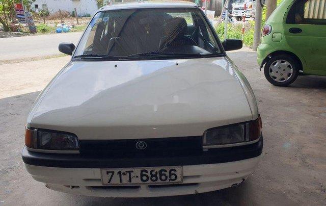 Bán lại xe Mazda 323 đời 1995, màu trắng, xe nhập, đồng sơn ok1
