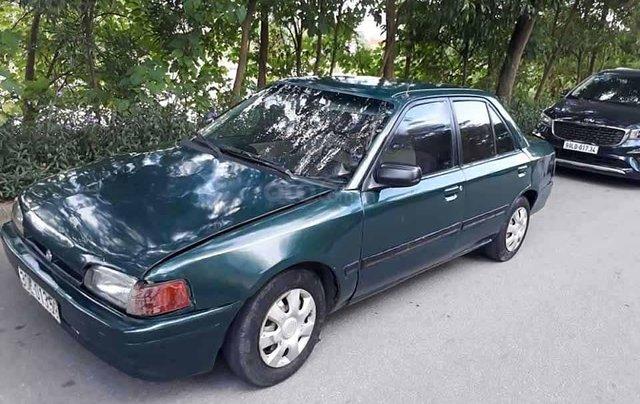 Cần bán lại xe Mazda 323 1.6 MT năm 1996, màu xanh lam, nhập khẩu nguyên chiếc  0