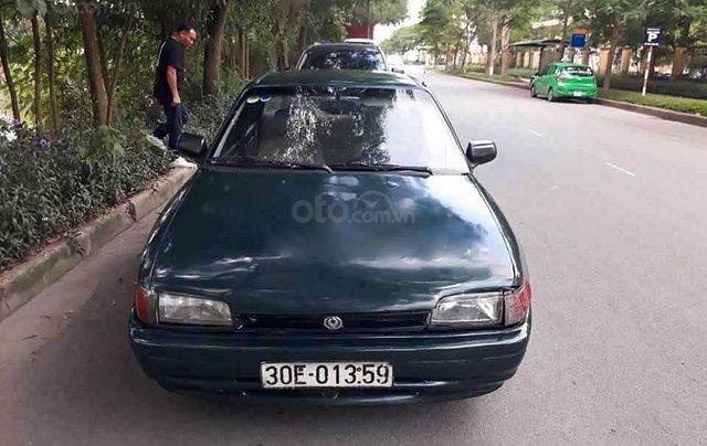 Cần bán lại xe Mazda 323 1.6 MT năm 1996, màu xanh lam, nhập khẩu nguyên chiếc  3
