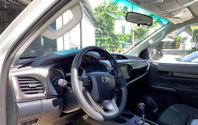 Cần bán xe Toyota Hilux 2.4L 4x2 AT đời 2021, màu trắng, xe nhập4