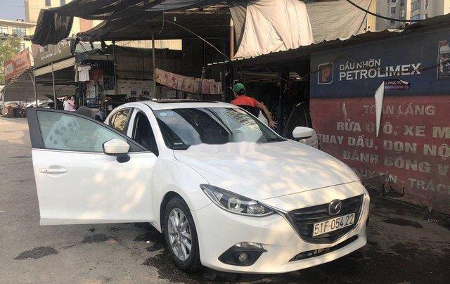 Cần bán xe Mazda 3 đời 2015, màu trắng, giá chỉ 485 triệu4