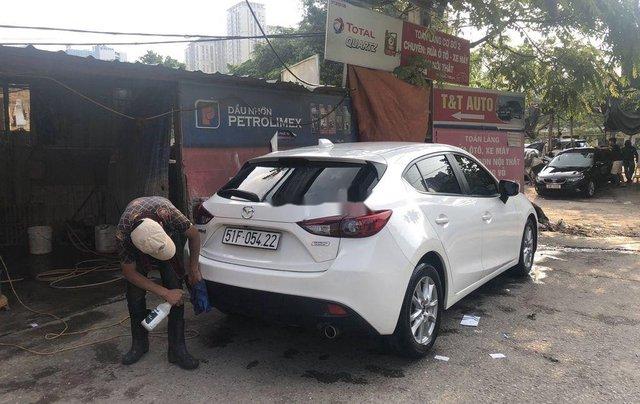 Cần bán xe Mazda 3 đời 2015, màu trắng, giá chỉ 485 triệu2