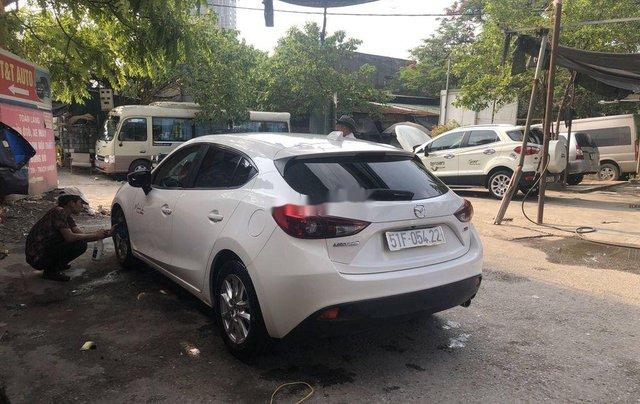 Cần bán xe Mazda 3 đời 2015, màu trắng, giá chỉ 485 triệu3