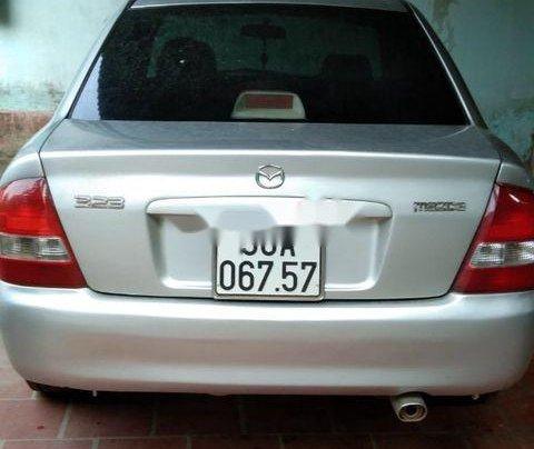 Bán Mazda 323 đời 2001, màu bạc0