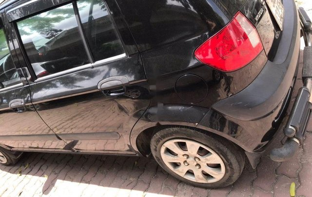 Cần bán Hyundai Getz 1.4 AT đời 2010, màu đen, xe nhập như mới1