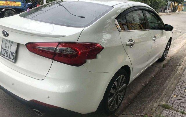 Bán Kia K3 đời 2014, màu trắng, nhập khẩu, có cam lùi, cửa sổ trời2