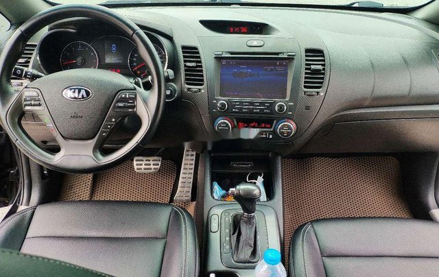 Cần bán xe Kia K3 đời 2015, màu đen còn mới6