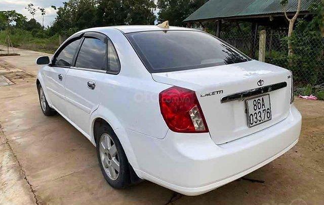 Cần bán lại xe Daewoo Lacetti 1.8 2004, màu trắng còn mới 2
